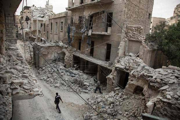 A Syrian man walks past destroyed buildings on May 2, 2016, in Aleppo's Bab al-Hadid neighbourhood which was targeted recently by regime air strikes. Aleppo residents ventured out onto the streets, taking advantage of a lull in violence in the northern Syrian city as the United States pushed to salvage a ceasefire.