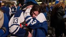A fan cries as the Boston Bruins defeat Toronto Maple Leafs 5-4 at Toronto's Maple Leaf Square during overtime of game seven of the first round of NHL Stanley Cup Playoff series on Monday, May 13, 2013. (Michelle Siu/The Globe and Mail)