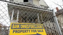 A sign is displayed in front of a foreclosed home in Bridgeport, Conn. (Spencer Platt/Getty Images)