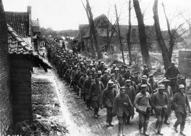 German soldiers captured at Vimy march toward a prisoner-of-war camp.