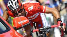 "Katusha Team's Joaquin ""Purito"" Rodriguez of Spain talks with his director as he cycles during the seventh stage of the Tour of Spain ""La Vuelta"" cycling race between Huesca and Alcaniz August 24, 2012. ) (FELIX ORDONEZ/REUTERS)"