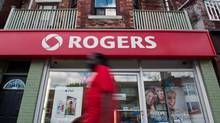 A man walks by a Rogers store in Toronto, Wednesday, August 15, 2013. (Galit Rodan/THE CANADIAN PRESS)