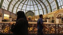 A woman walks near the fashion dome at the shopping centre Mall of the Emirates in Dubai, January 11, 2012. (JUMANA EL HELOUEH/REUTERS)
