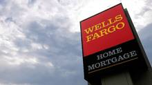 The U.S. Justice Department has fined Wells Fargo bank for discrimination in its mortgage lending. (Seth Perlman/Associated Press)