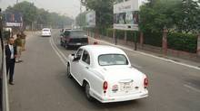 Stephen Harper's black armour-clad vehicle with Ontario license plates in India (Steven Chase/The Globe and Mail)