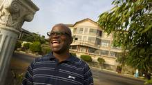 Wilfred Sam King refuses to leave his homeland of Sierra Leone, and today has created a $20-million empire of hotels, shops and other businesses in his native Sierra Leone. (Peter Power/The Globe and Mail)