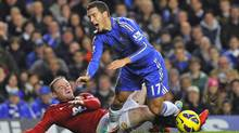 Manchester United's Wayne Rooney makes a late tackle on Chelsea's Eden Hazard to earn himself a yellow card during their English Premier League soccer match at Stamford Bridge in London October 28, 2012. (Reuters)