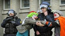 Climate-change demonstrators hug a police officer during a march that drew tens of thousands in Copenhagen on December 12, 2009.