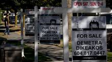 For sale signs are seen outside homes for sale in the Kitsilano neighborhood in Vancouver, B.C. (DARRYL DYCK For The Globe and Mail)