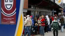 Montreal Canadiens fans line up around the Bell Centre for playoff tickets in Montreal Wednesday, April 21, 2004. An ongoing probe into government corruption in Quebec has repeatedly heard how Montreal Canadiens tickets were a currency of choice when it came to corrupting public officials. (RYAN REMIORZ/CP)