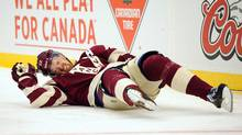 Vancouver Canucks left wing Daniel Sedin (22) lays on the ice after being boarded by Ottawa Senators defenceman Marc Methot (not pictured) during the second period in the Heritage Classic hockey game at BC Place. (Anne-Marie Sorvin/USA Today Sports)