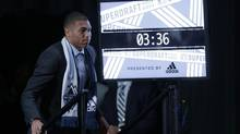 Christian Dean walks to the stage after being selected by Vancouver Whitecaps (Matt Rourke/AP)