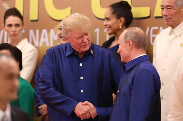 Danang, Vietnam, Nov. 10: U.S. President Donald Trump shakes hands with Russia's President Vladimir Putin as they pose for a group photo ahead of the Asia-Pacific Economic Co-operation summit leaders gala dinner.