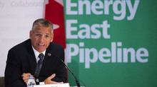 TransCanada CEO Russ Girling announces the company is moving forward with the 1.1 million barrel-per-day Energy East Pipeline project at a news conference in Calgary, Alta., Thursday, Aug. 1, 2013. (Jeff McIntosh/The Canadian Press)