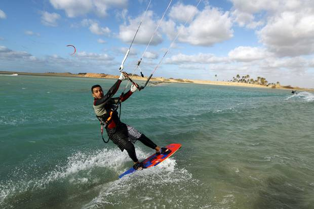 The gear is expensive and the learning curve is steep, but kiteboarding junkies insist that the exhilaration makes it all worth it.