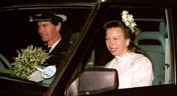Commander Tim Laurence (L) and Britain's Princess Anne are seen in their car after their wedding at Crathie Church 12 December 1992 in Scotland.