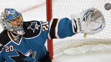San Jose Sharks goalie Evgeni Nabokov watches the puck sail past his glove against the Colorado Avalanche during the second period of Game 1 of their NHL Western Conference quarter-final hockey game in San Jose, California April 14, 2010. REUTERS/Robert Galbraith (ROBERT GALBRAITH)