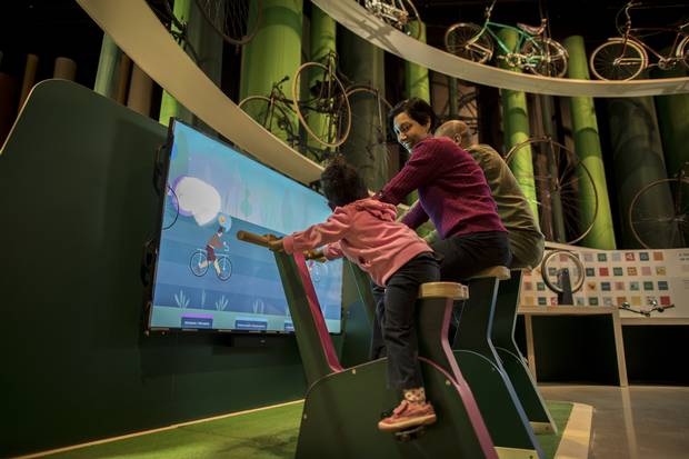 A family plays with one of the museum's interactive exhibits.