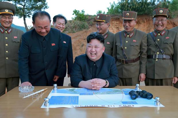 North Korean leader Kim Jong-un smiles during a May missile test. Mr. Kim said 'the United States would suffer a