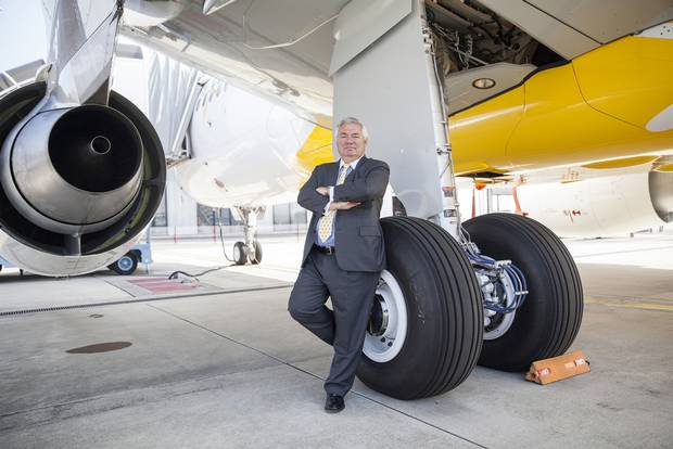 Airbus's John Leahy poses for a photograph during an event to mark the debut flight of the Airbus A320neo aircraft in 2014.