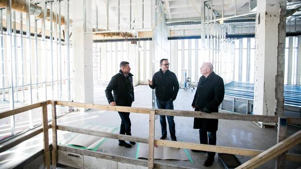 Perimeter Development partners Stewart Barclay, left, Craig Beattie, and David Gibson are active in reshaping downtown Kitchener. They've renovated a few historic buildings in addition to embarking on building the first Class A tower in the city in 25 years.