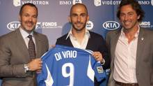 Former Italy and Bologna forward Marco Di Vaio is flanked by team president Joey Saputo, left, and sporting director Nick DeSantis as he is introduced to the media as the Montreal Impact's designated player at a news conference in Montreal on Monday, May 28, 2012. (The Canadian Press)