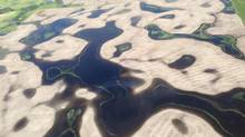 An aerial view of the flooding about ten miles north of Alida, in southeast Saskatchewan, is shown on Wednesday, July 2, 2014. Nearly 90 communities in Saskatchewan and Manitoba have declared emergencies because of flooding and more than 500 people have been forced to leave their homes. (Don Healy/THE CANADIAN PRESS)