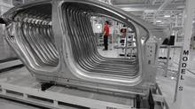 In this Friday, June 22, 2012, file photo, Tesla Model S frames are shown in the assembly area at the Tesla factory in Fremont, Calif. (Paul Sakuma/AP)