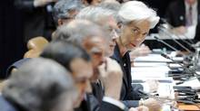 France's then-Minister of Economy Christine Lagarde, right, and colleagues at work during a session of G20 finance ministers and central bank governors in Washington in April, 2011. (JONATHAN ERNST/REUTERS)