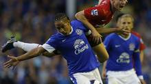 Everton's Steven Pienaar (L) challenges Manchester United's Tom Cleverley during their English Premier League soccer match at Goodison Park in Liverpool, northern England, August 20, 2012. Billionaire money manager George Soros reported a nearly 2 percent stake in Manchester United Plc on Monday, in one of the first revelations of investors in the British soccer club's controversial initial public offering earlier this month. (Phil Noble/REUTERS)