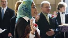 Izza Ahmed of Toronto, and originally of Pakistan, takes an oath at a Canadian citizenship ceremony in Ottawa, Friday February 16, 2007. (FRED CHARTRAND/CP)