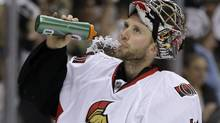 Ottawa Senators goalie Craig Anderson takes a drink after allowing a goal to Pittsburgh Penguins forward Chris Kunitz in the second period of Game 1 of their Stanley Cup second-round playoff series against the Pittsburgh Penguins in Pittsburgh Tuesday, May 14, 2013. The Penguins won 4-1. (Gene J. Puskar/AP)