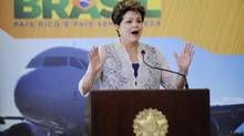 Brazil's President Dilma Rousseff gestures during the launching ceremony of an investment plan at airports, in Brasilia Dec. 20, 2012. While air travel has expanded rapidly in Brazil – an area larger than the 48 contiguous U.S. states – the country's aging airports have long been starved of investment. (Stringer/brazil/Reuters)