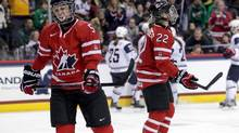 Canada defenceman Lauriane Rougeau (5) and forward Hayley Wickenheiser (22) react after allowing a goal during the first period against USA in an exhibition hockey game at Xcel Energy Center. (Brace Hemmelgarn/USA Today Sports)