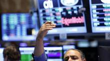 A trader signals to for a price on the floor at the New York Stock Exchange, June 26, 2013. (BRENDAN MCDERMID/REUTERS)