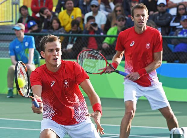 Canada's Vasek Pospisil, left, and teammate Daniel Nestor returns to Spain's Marc Lopez and Rafael Nadal in men's doubles tennis semifinal action at the 2016 Olympic Games in Rio de Janeiro, Brazil on Thursday, Aug. 11, 2016.