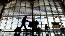 Travelers walk through the concourse at Reagan National Airport in Washington, DC, ahead of Thanksgiving Day. (JEWEL SAMAD/JEWEL SAMAD/AFP/Getty Images)