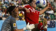 Kara Lang, right, is seen here competing for Canada at the FIFA Women's World Cup in China in 2007. (DAVID GRAY/REUTERS)