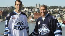 AHL St. John's IceCaps President and Chief Eecutive Officer Danny Williams and team right-winger Jason King, left, a native of Corner Brook, NL, unveil the teams new jerseys at Fort Waldegrave by the Outer Battery near St. John's Harbour, Thursday Sept. 22, 2011. The shoulder flash on the jerseys is that of their parent NHL club the Winnipeg Jets. THE CANADIAN PRESS/ Joe Gibbons (Joe Gibbons/CP)