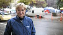 Vancouver mayoral candidate Suzanne Anton poses for a photo across the street from the Occupy Vancouver tent city on OCt. 26, 2011. (Brett Beadle/Brett Beadle for The Globe and Mail)