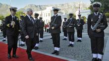 Canada's Governor General David Johnston reviews the honour guard during the official welcoming ceremony in Cape Town May 21, 2013 with Table Mountain looming in the background. (Sgt Ronald Duchesne/Rideau Hall)