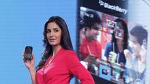 Bollywood actress Katrina Kaif poses with the newly launched BlackBerry Curve 9220 smartphone in New Delhi April 18, 2012. (ADNAN ABIDI/ADNAN ABIDI/REUTERS)