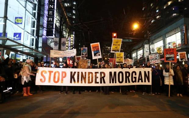 Protesters walk down Robson Street in opposition to Canada's decision to approve Kinder Morgan's pipeline from the Alberta oil sands to the Pacific coast in Vancouver, B.C., on Nov. 29, 2016.