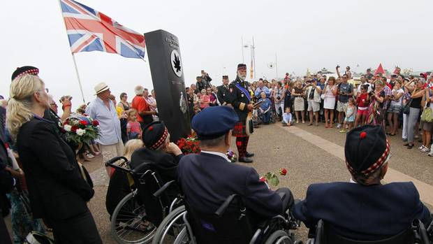 Britain's Prince Michael of Kent, centre with beard, delivers a speech, during the commemorations of the failed Second World War invasion, in Dieppe, northern France, Sunday Aug. 19, 2012. (Michel Spingler/AP)