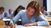 Women report spending more time studying than men. (Robert Kneschke/Getty Images/iStockphoto)