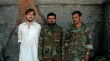 Graeme Smith, left, on the western outskirts of Kandahar city, with a couple of Afghan National Army troops in September of 2005.