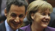 Greece needs approval from the euro-zone ministers, led by German Chancellor Angela Merkel and French President Nicolas Sarkozy, to launch its debt-swap scheme. (Geert Vanden Wijngaert/AP/Geert Vanden Wijngaert/AP)
