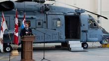 Defence Minister Peter MacKay addresses crew and technicians after inspecting a new Sikorsky CH-148 Cyclone helicopter at CFB Shearwater outside Halifax on May 26, 2011. (Andrew Vaughan/The Canadian Press)