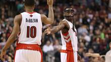 Toronto Raptors forward Patrick Patterson (54) is congratulated by guard DeMar DeRozan (10) after scoring a basket against the New Orleans Pelicans at Air Canada Centre. The Raptors beat the Pelicans 108-101. (Tom Szczerbowski/USA Today Sports)