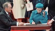 The Queen signs Canada's constitutional proclamation in Ottawa on April 17, 1982 as Prime Minister Pierre Trudeau looks on. (RON POLING/Ron Poling/The Canadian Press)